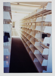 Upper level shelving by Library